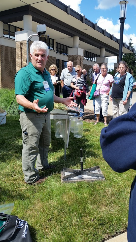 "paul gross, field crops educator from isabella county, presenting ""when it rains.....rainfall simulator"" (photo courtesy of Linda  whitlock)"