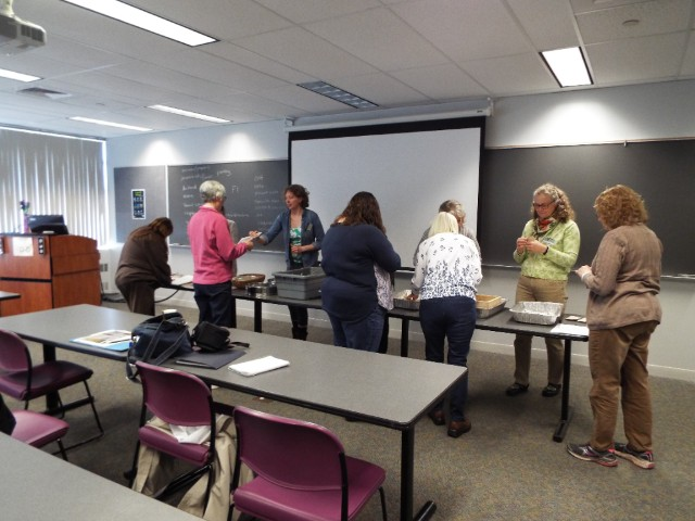 "Participants in Abbey Palmer's class get a feeling for seed saving.  Some said the feeling was a ""new respect for the effort involved in the process""."
