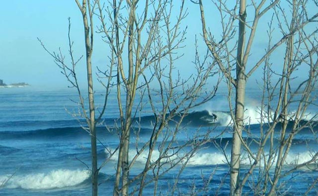 Will Wall surfing at Stoney Point, Lake Superior. Photo by Burton Hathaway