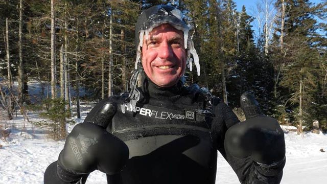 Burton Hathaway after surfing at Stoney Point on Lake Superior in sub-zero conditions. Photo by Erik Wilkie