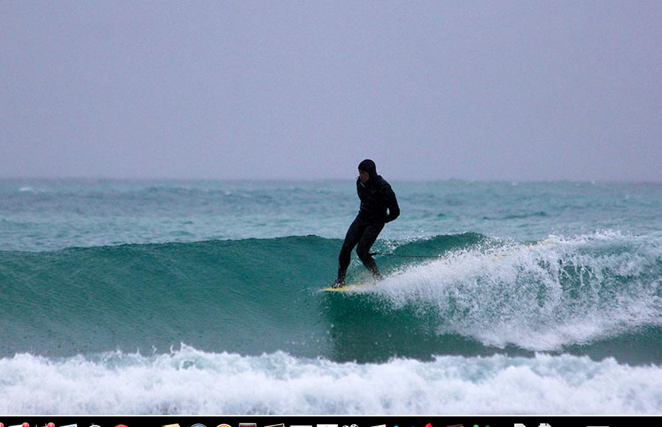 Thien Pham hangs five in the just-thawed-out Great Lakes. Photo by Brian Tanis