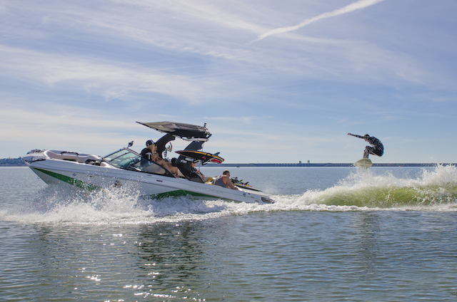 Hunter Clement Boosting Behind Centurion Boats FS33 on His SoulCraft Board