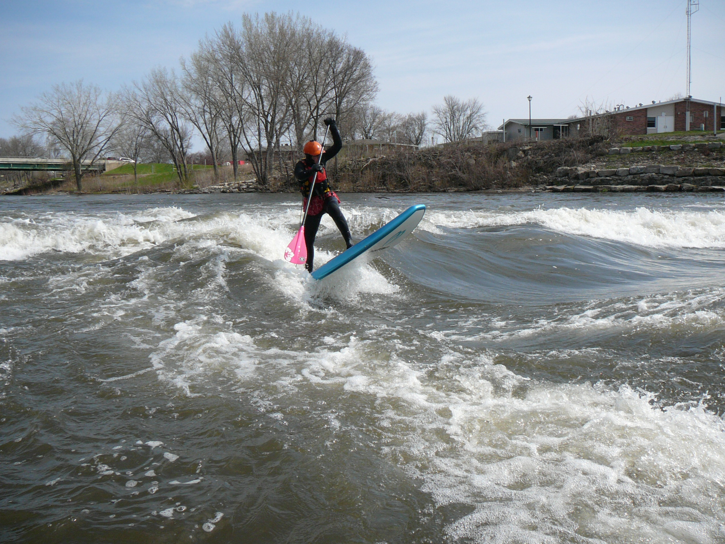 Hannah Childs river surfing in Charles City