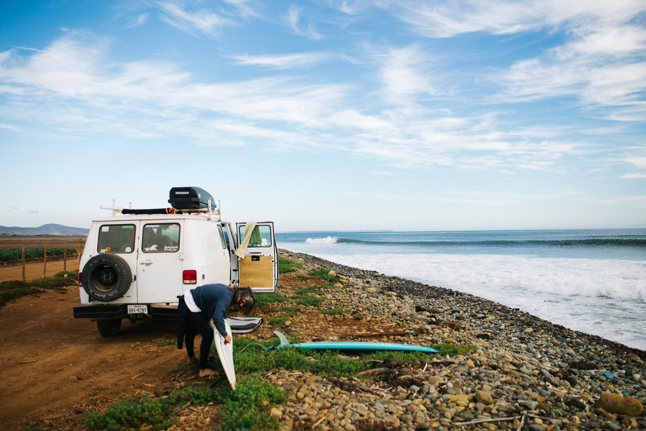 """From Texas to Baja for some surf. Dylan Phillip waxing up next to his Van called """"Pearl"""" Photo by Sam Matthews"""