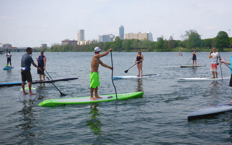 Danny Ching at a paddle clinic in Austin. Neon green shorts and neon green board = FLARE!
