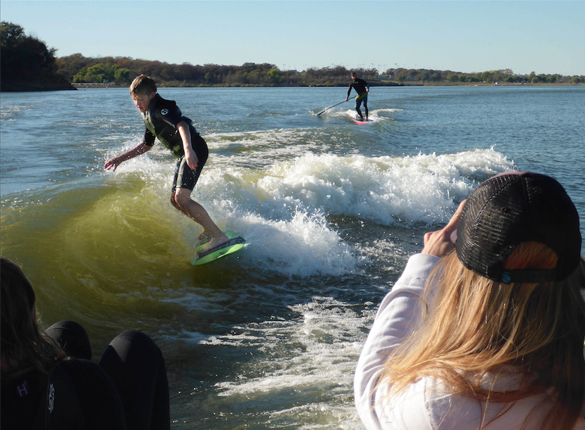 Winter time surfing in North Texas with the  DFW Surf  Club. Perry Morrison rocking a spring suit and Nate Richard SUP Surfing with a 3/2 wetsuit