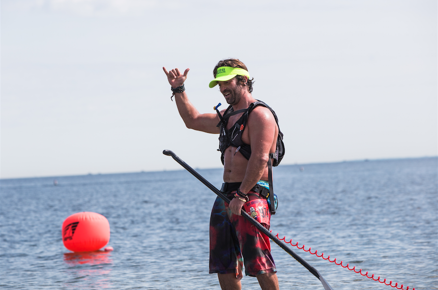 """Jeramie Vaine, always embracing an """"Aloha"""" vibe. Picture taken at the inaugural Bay to Bridge Paddle Race in Annapolis Maryland by  Waxbeard Images"""