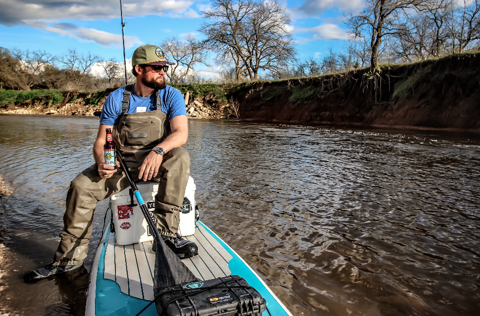 Hunter Harlow on Childress Creek with his Yeti cooler and  Bote Board