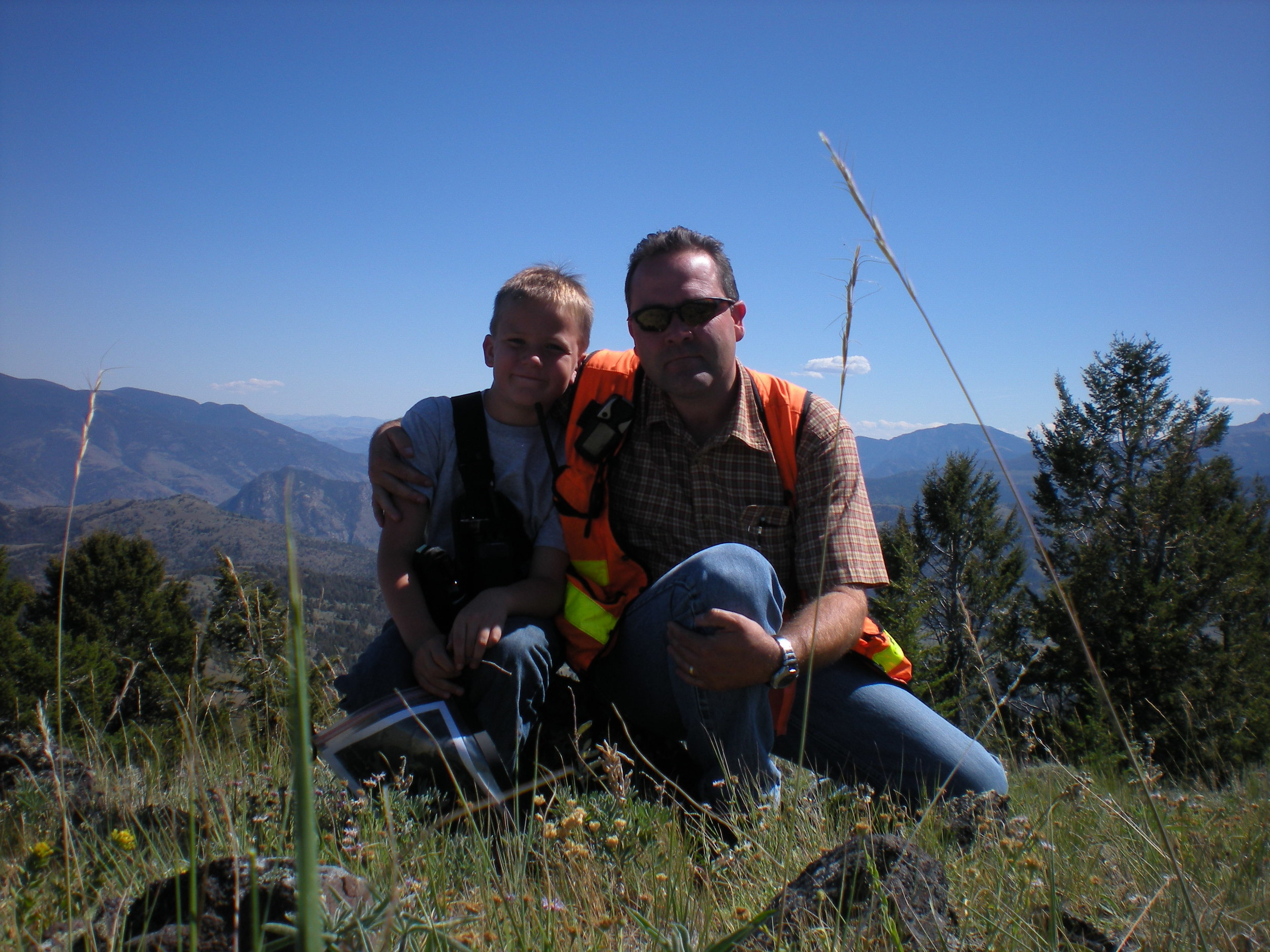 Jerry & Jordan running section lines next to Yellowstone Park