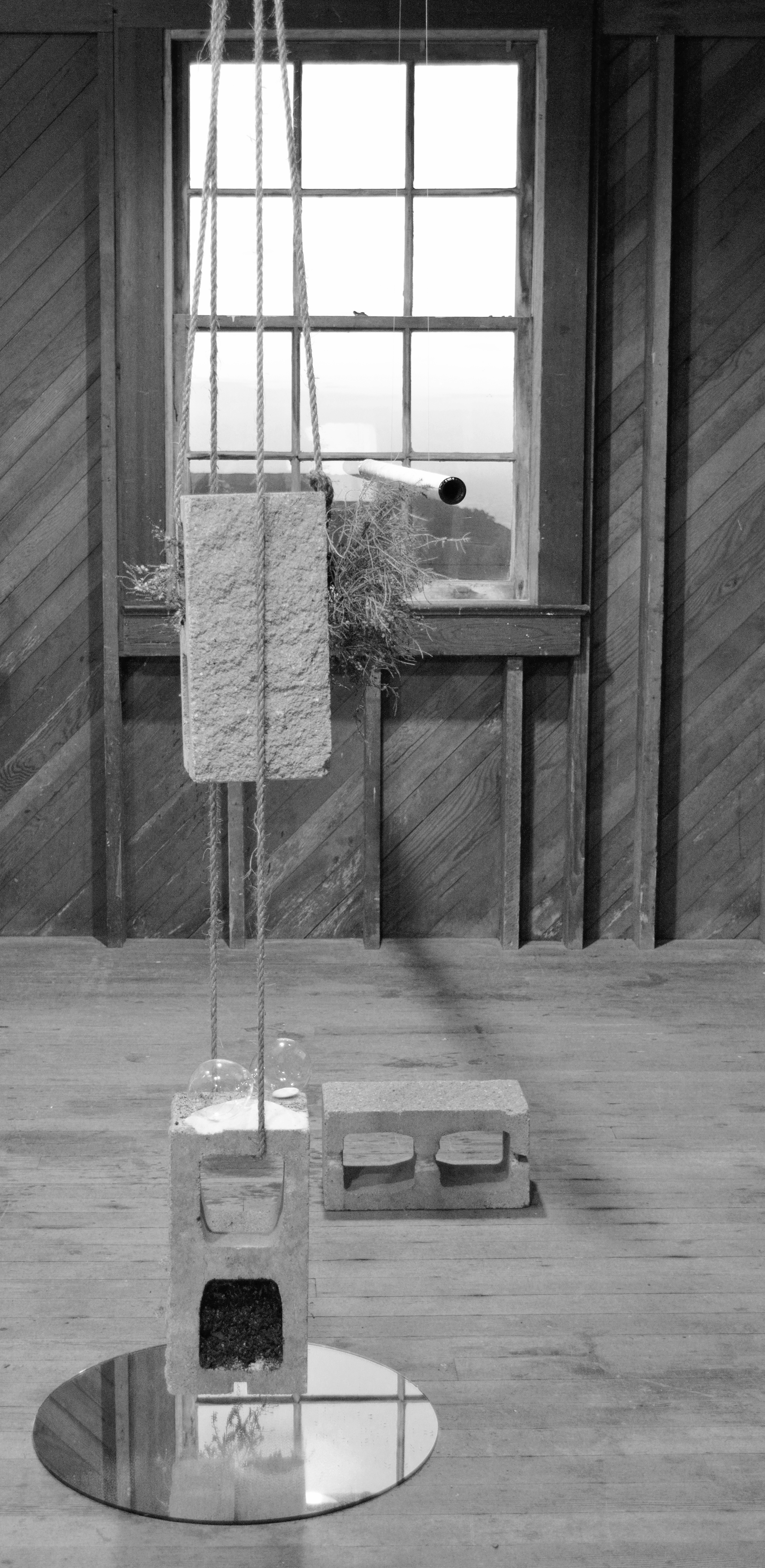 Ghost hills (Erica x darleyensis) , 2014, Studio Installation view.  concrete blocks, mirror, heather plants, soil, manilla rope, cardboard, hourglass, graphite, metal leaf, gesso, repurposed plastic, fishing line. Headlands Center for the Arts, Spring Open House 2014, Sausalito, CA