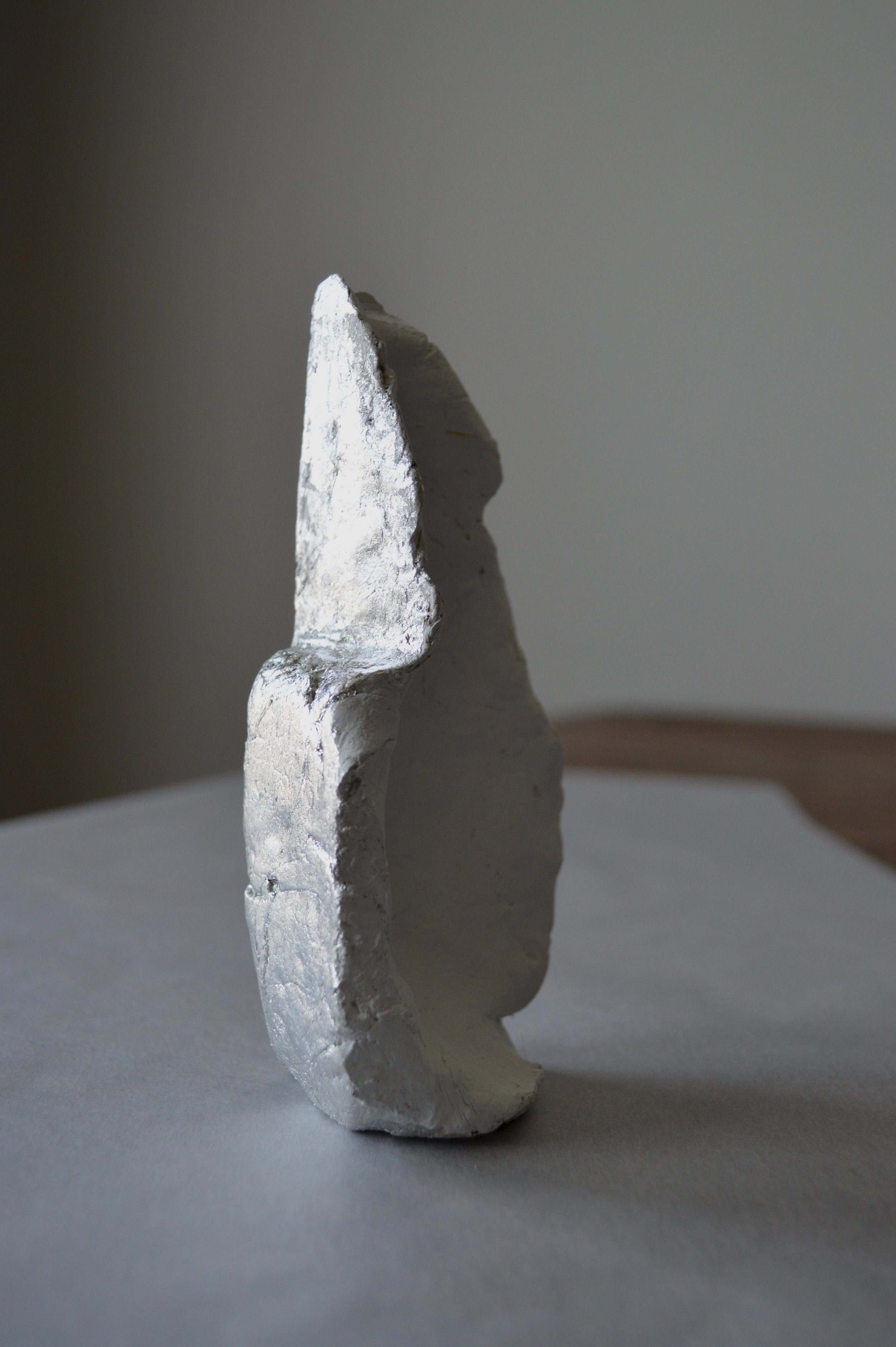 """Untitled, (corner AG).   site: anterior gallery. material: air dry clay, silver leaf, gesso, matte medium. 5.5"""" x 3"""" x 2.5"""", May 2019"""