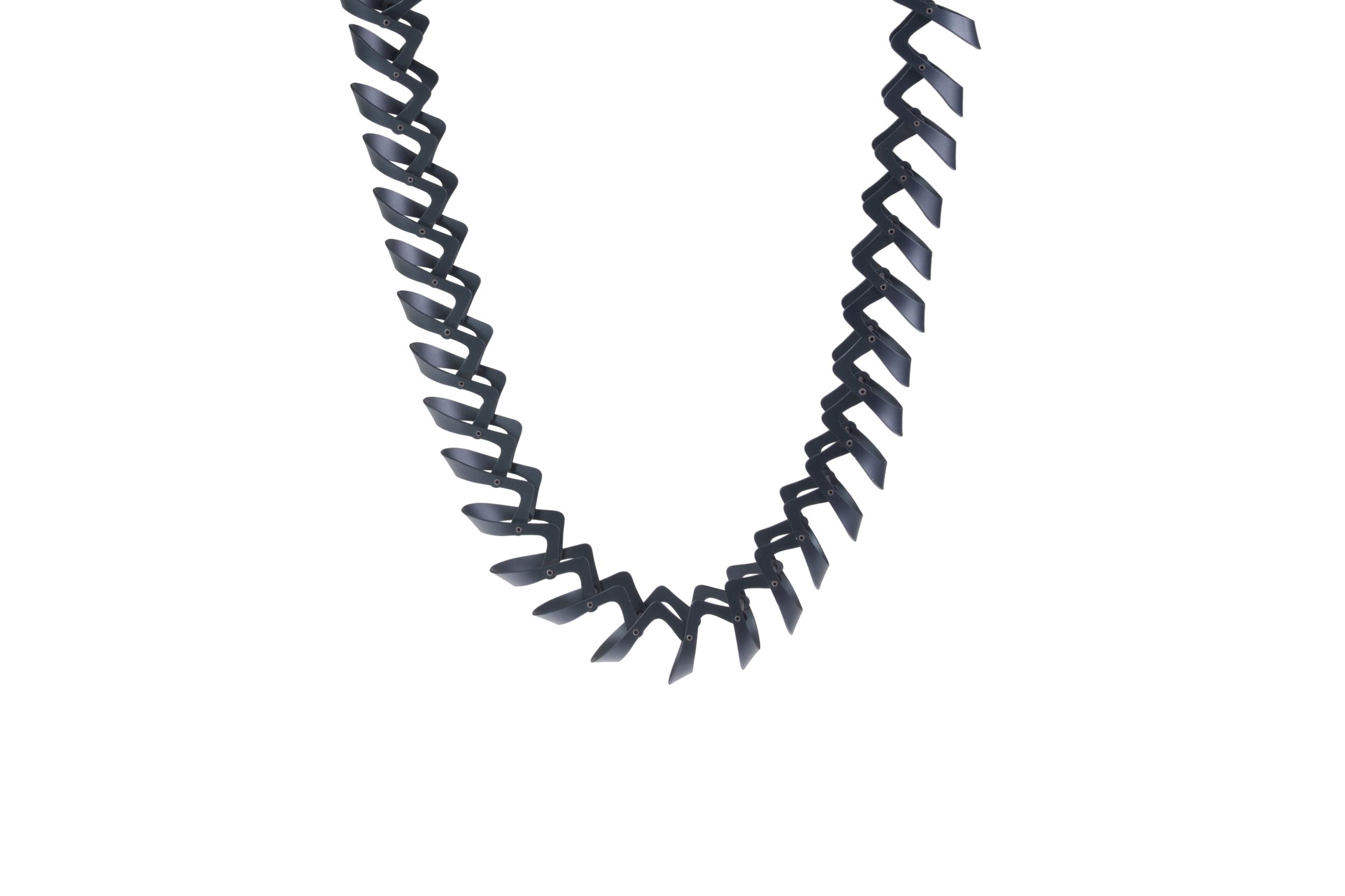 Neckpiece  Neckpiece:   Bespoke Wearables project    Press cut and hand assembled Aluminium, silver