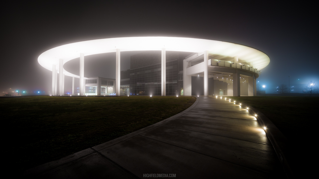 The Long Center produces a faint glow in the midnight fog.