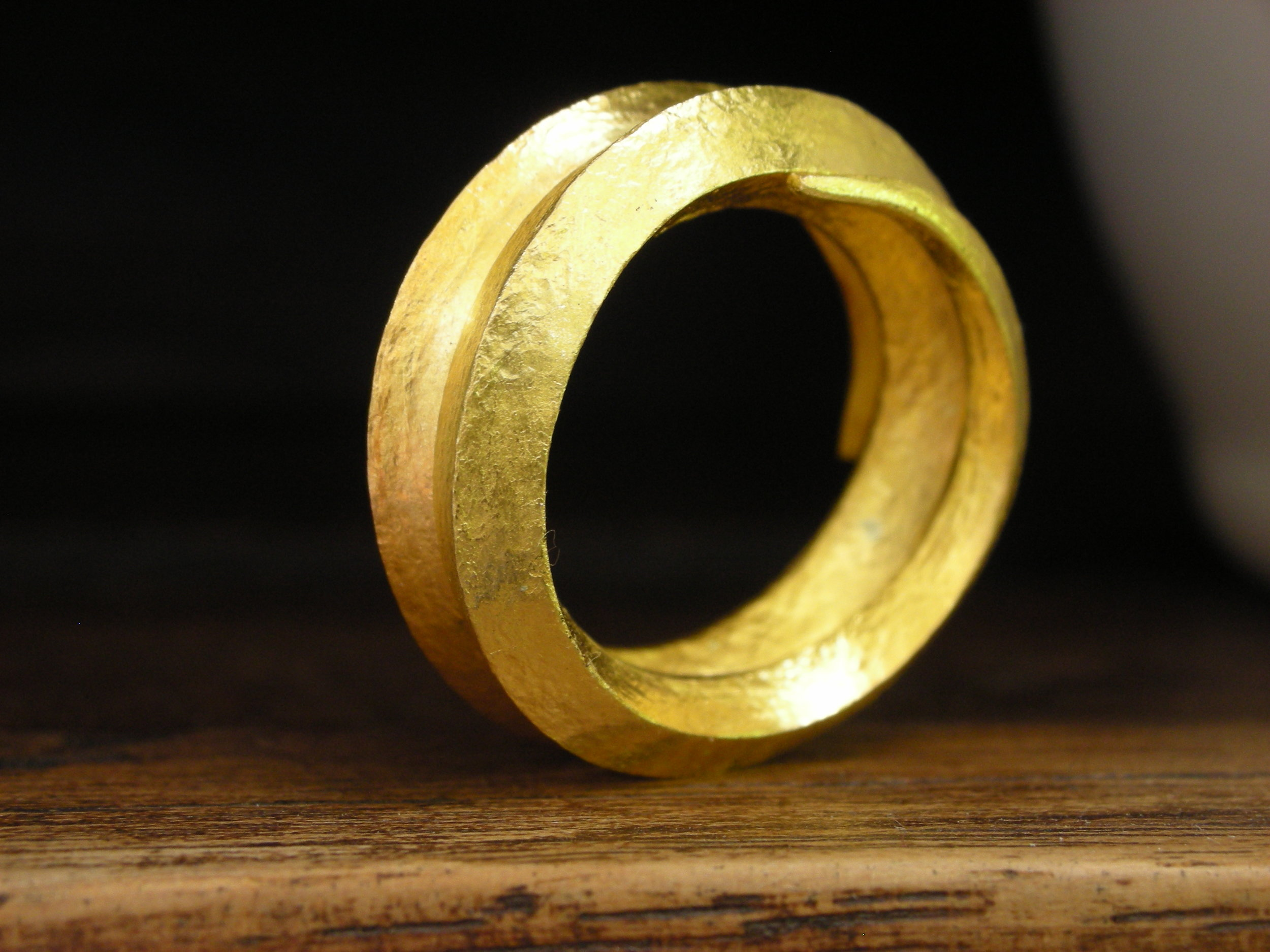 Hand forged from 24k gold. This was a happy accident of letting the process take you where it seems to want to go.