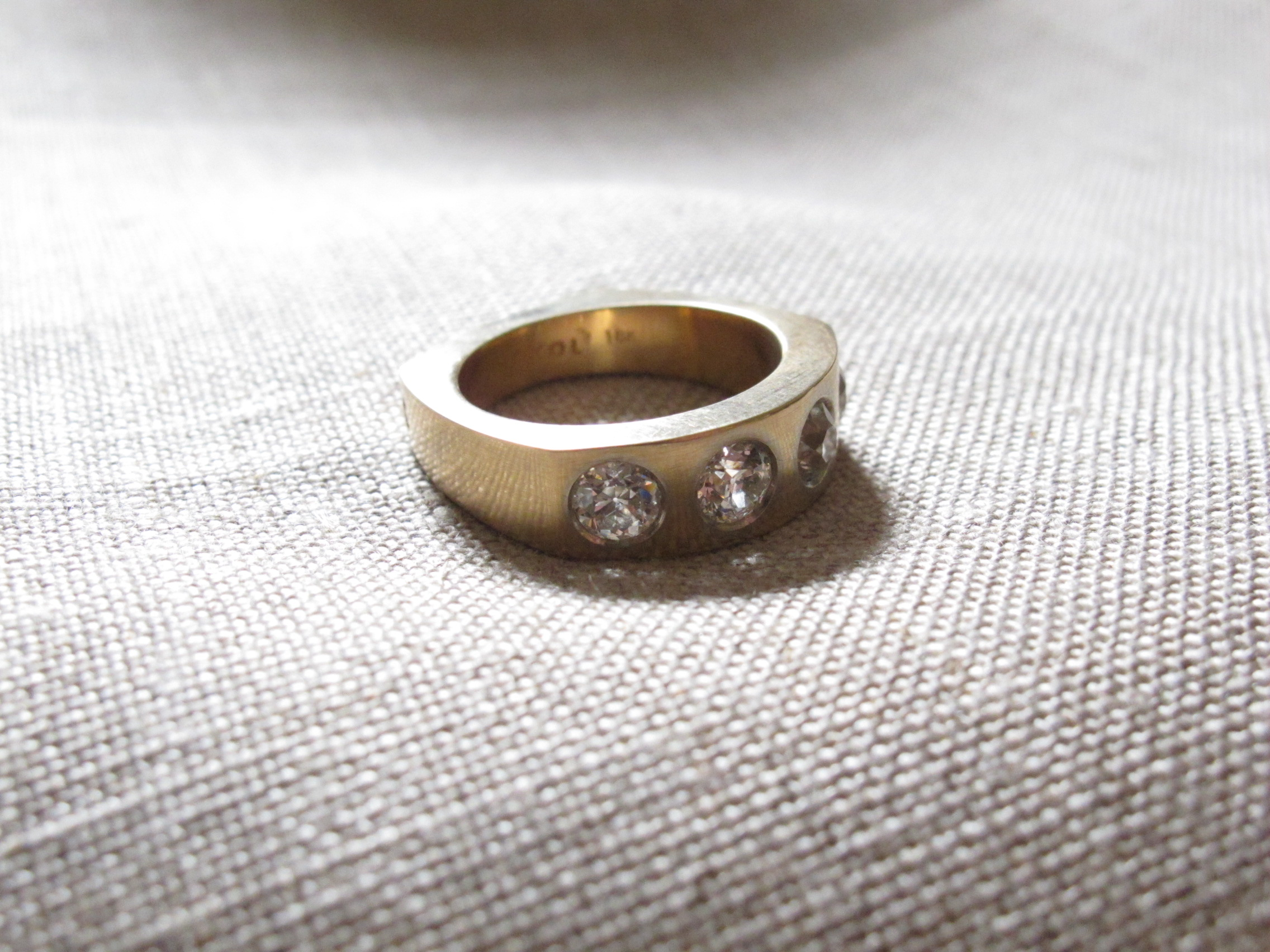 Designed for an avid gardener, using inherited stones from her mother. I carved a wax and it was cast in 18k gold.