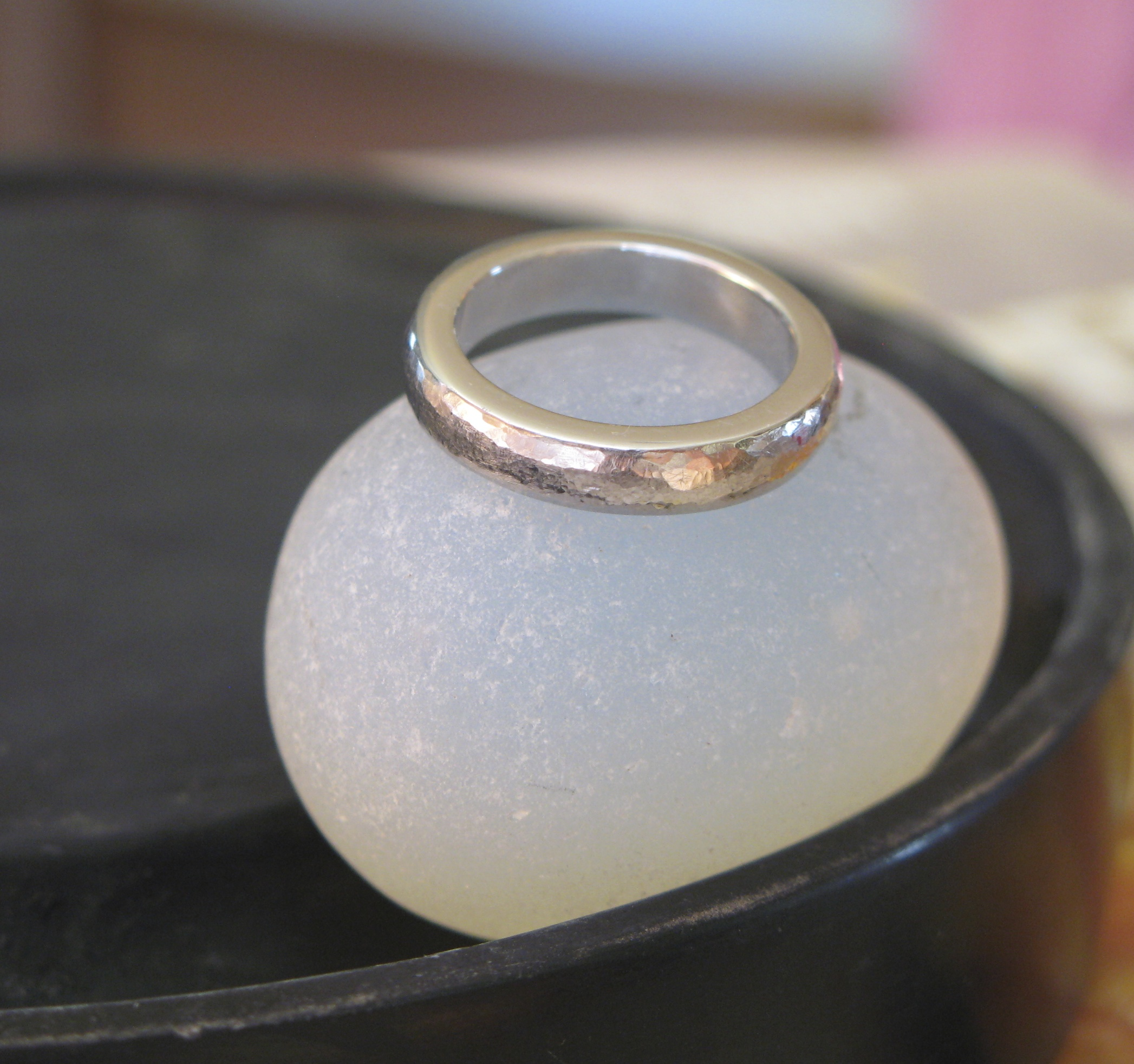 This is a custom platinum wedding band, hand forged. It has a satisfying weight, and lovely hand pounded texture.