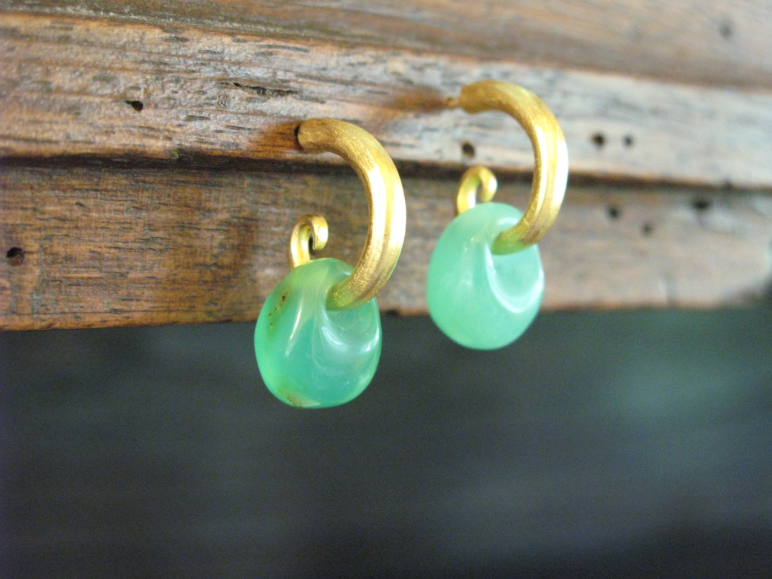 This is a smaller version of the irresistible hoops  made for a young woman.. The drops were hand carved by a stone carver.
