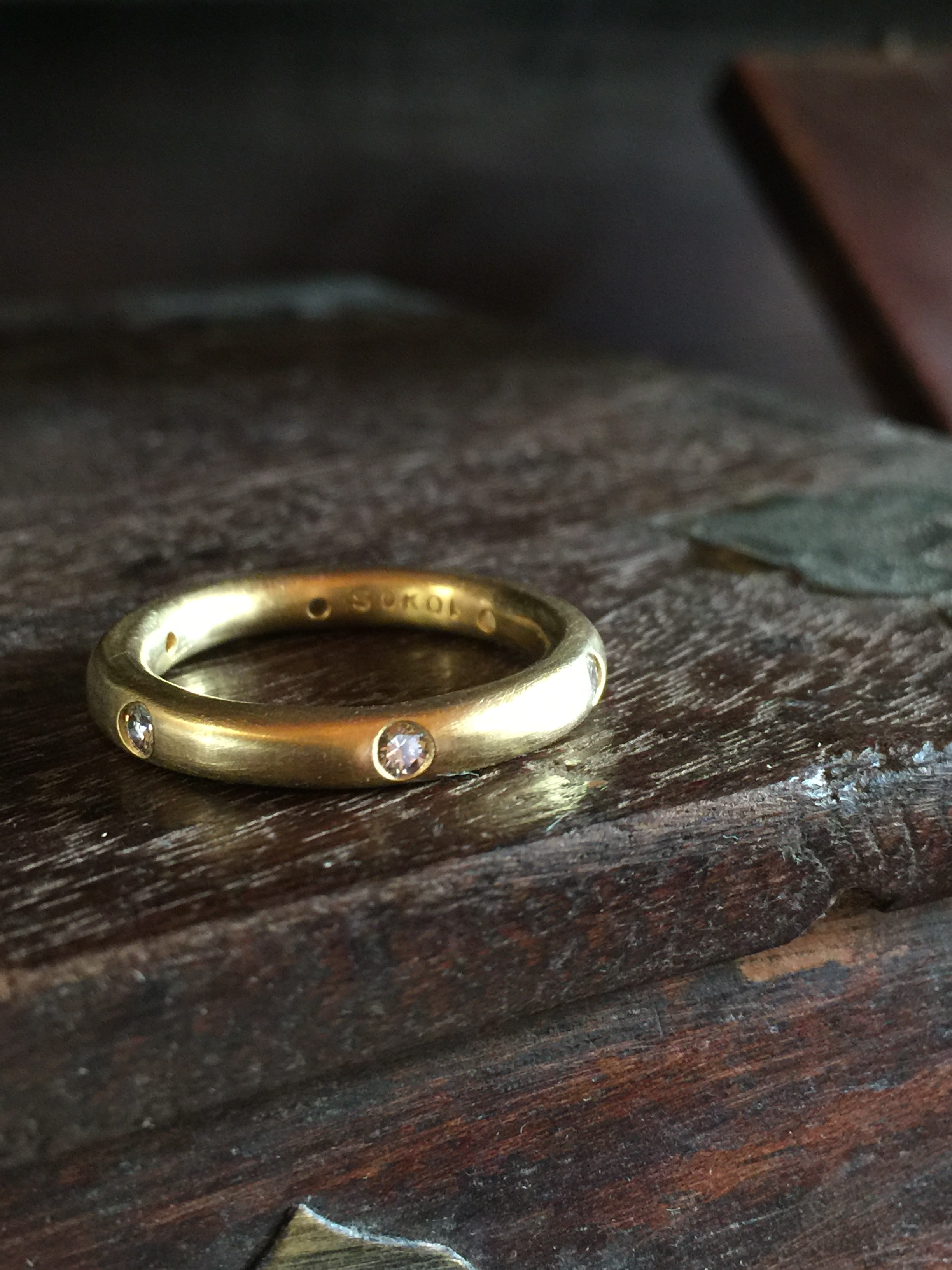 Hand forged band in 22k gold with 6 diamonds, I call this my Why Not ring. Equally wonderful with rubies or sapphires or in platinum. Can be made in many widths.