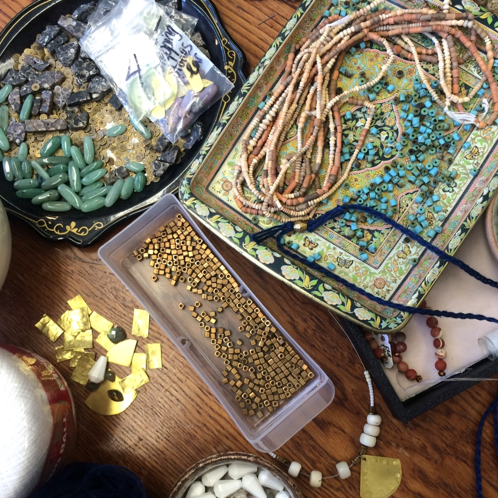 trays of turquoise and brass beads