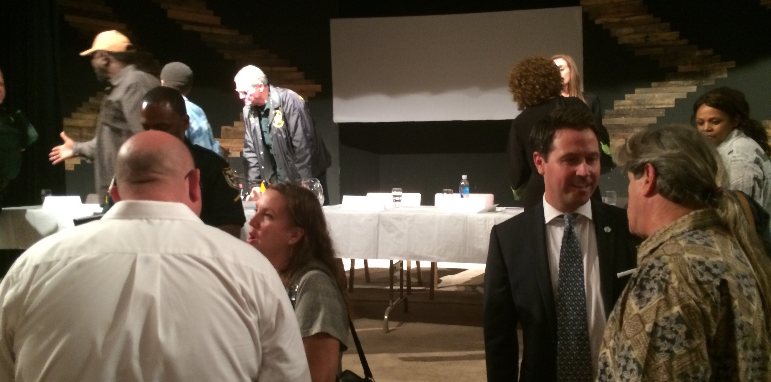 Residents lingered long after the District 3 town hall meeting ended to talk with their elected officials.