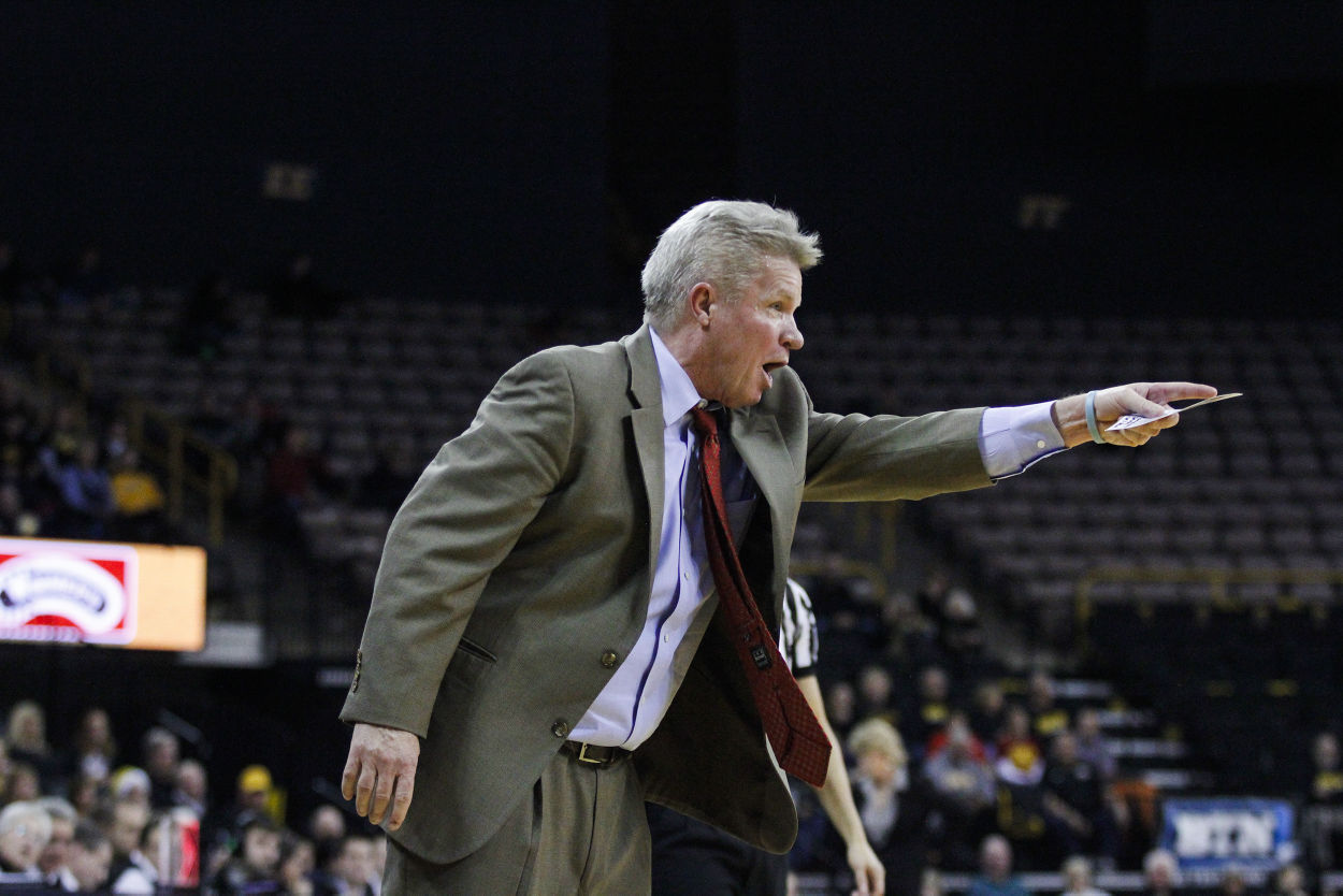ISU coach Bill Fennelly shouts at a referee during the game against Iowa at Carver-Hawkeye Arena in Iowa City on Dec. 11, 2014. The Cyclones fell to the Hawkeyes 76-67. Photo by: Kelby Wingert/Iowa State Daily