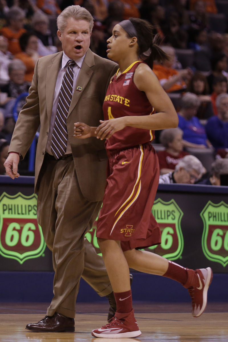 ISU women's basketball coach Bill Fennelly talks to junior guard Nikki Moody as she jogs toward the bench during Iowa State's 67-57 loss to Oklahoma State on March 8, 2014 at the Chesapeake Energy Arena in Oklahoma City, Oklahoma. Photo by: Brian Achenbach/Iowa State Daily.