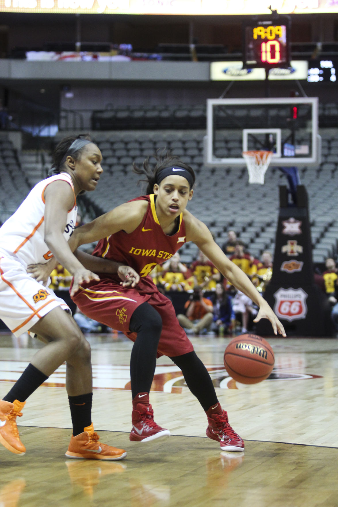 Senior guard Nikki Moody works her way around an opposing player against Oklahoma State in the third game of the 2015 Big 12 Championship in Dallas, Texas. The Cyclones fell to the Cowgirls 67-58. Photo by: Kelby Wingert/Iowa State Daily.