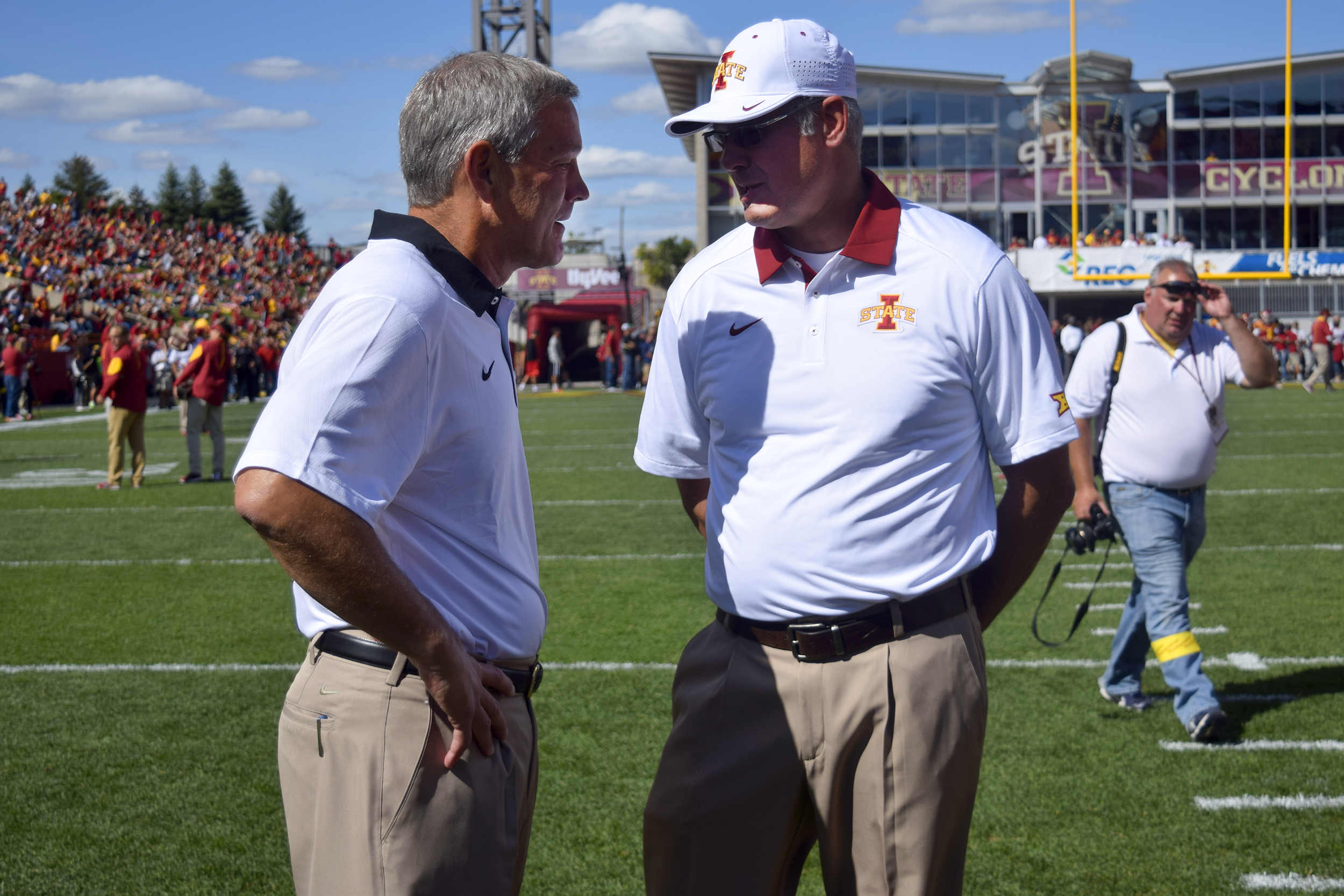 Kirk Ferentz (left) and Paul Rhoads talk briefly on the field before the Iowa vs. Iowa State game at Jack Trice Stadium in 2015. Photo by: Ryan Young/Iowa State Daily