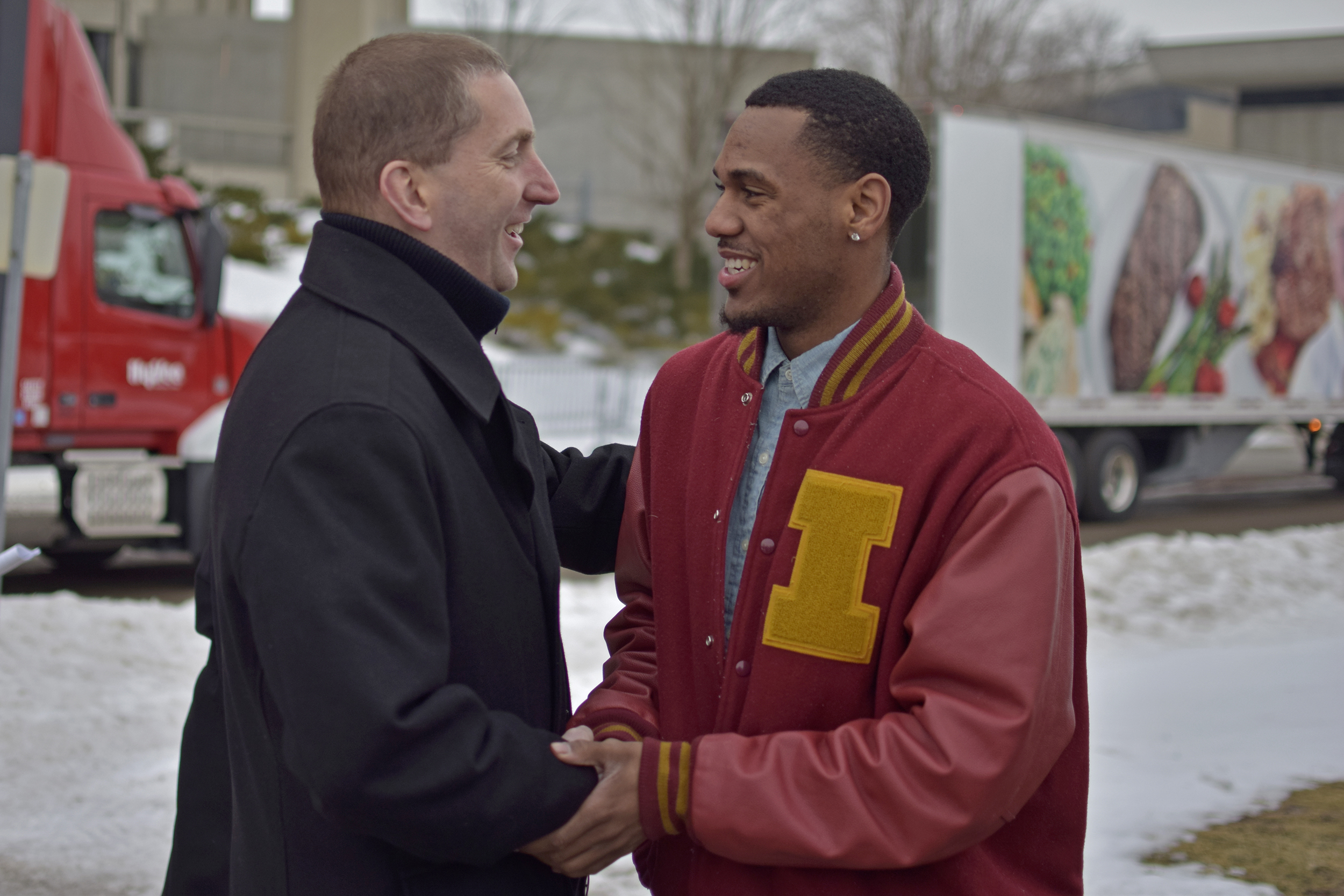 Iowa State Athletic Director Jamie Pollard and point guard Monte Morris talk outside of Hilton Coliseum on Thursday before 11 Hy-Vee trucks filled with drinking water depart for Flint, Michigan.  RyanYoung/IowaStateDaily.