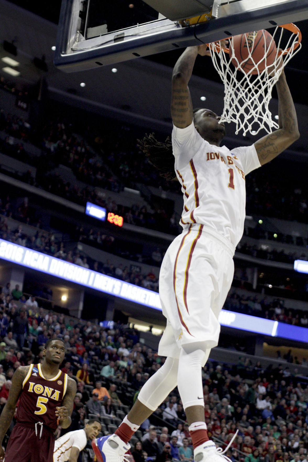 Senior Jameel McKay dunks the ball in the first round of the NCAA Tournament at the Pepsi Center in Denver. Photo by: Lani Tons/Iowa State Daily.