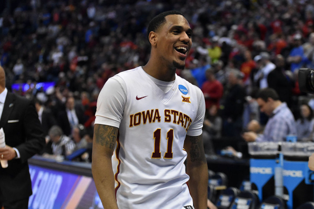 Point guard Monté Morris smiles as he heads to the locker room after the Cyclones 78-61 win over Little Rock in the second round of the NCAA Tournament at the Pepsi Center in Denver. Photo by: Lani Tons/Iowa State Daily