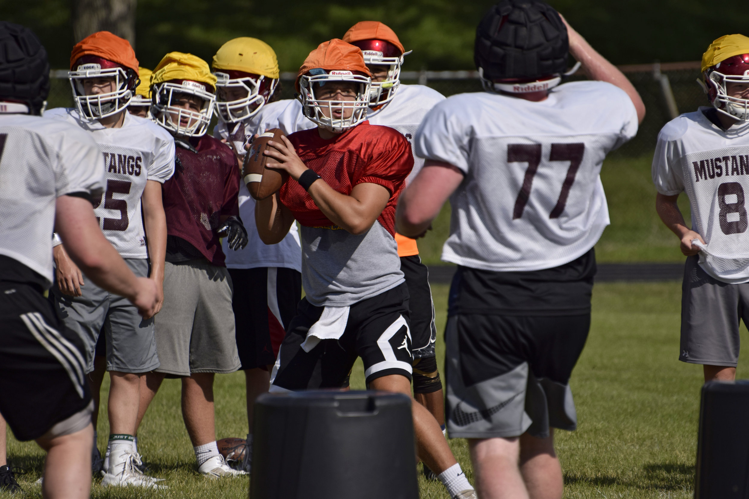 Mount Vernon quarterback Drew Adams throws the ball in a drill during a practice at Mount Vernon High School on Aug. 11. (Ryan Young/The Gazette)