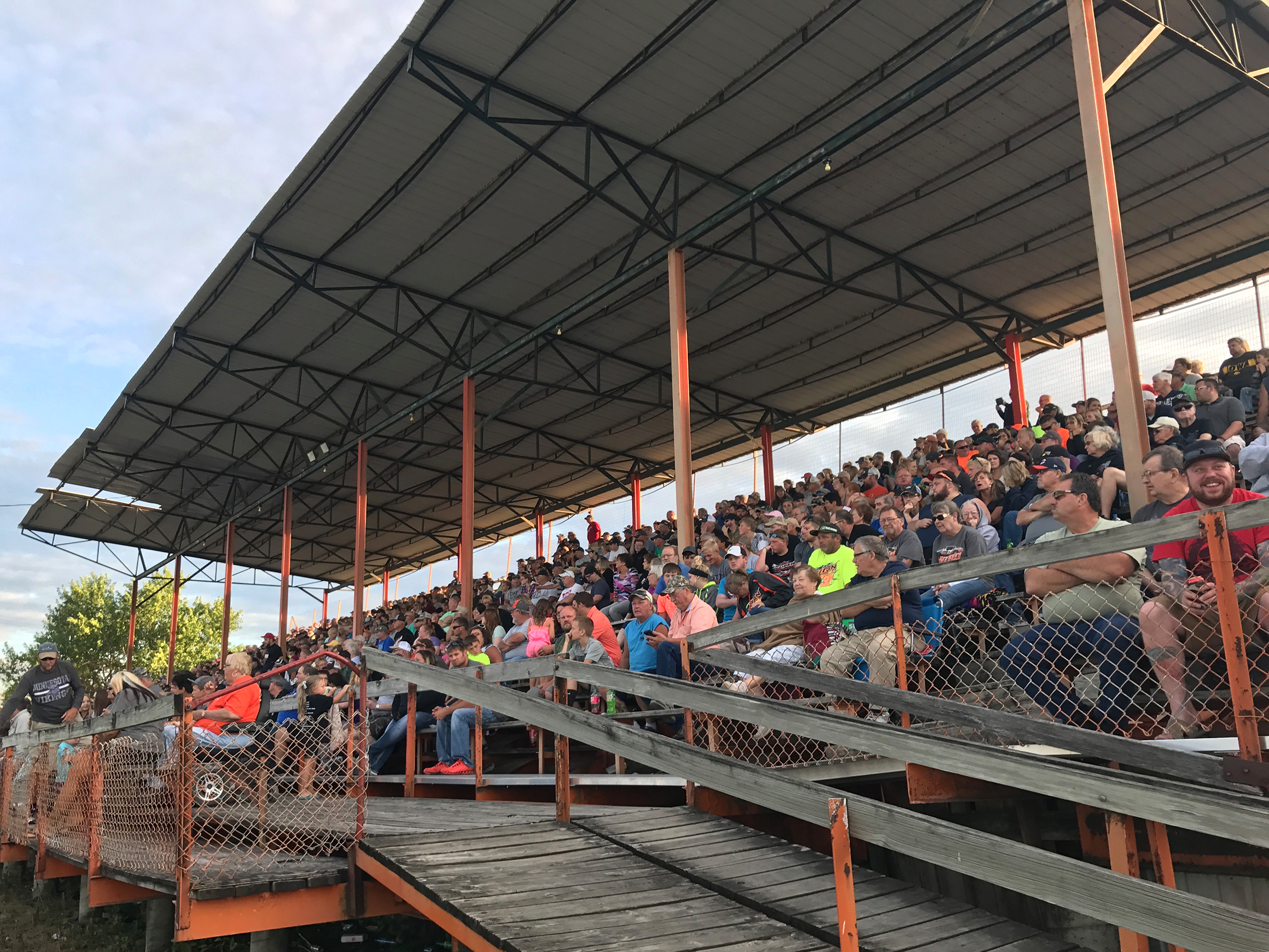 Hundreds of people packed the grandstands at the Benton County Speedway in Vinton, Iowa, on a Sunday night in June for the weekly races. (Ryan Young/The Gazette)