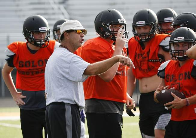 Solon football coach Kevin Miller talks with his team during a practice this fall at Solon High School. (Tork Mason/Freelance)