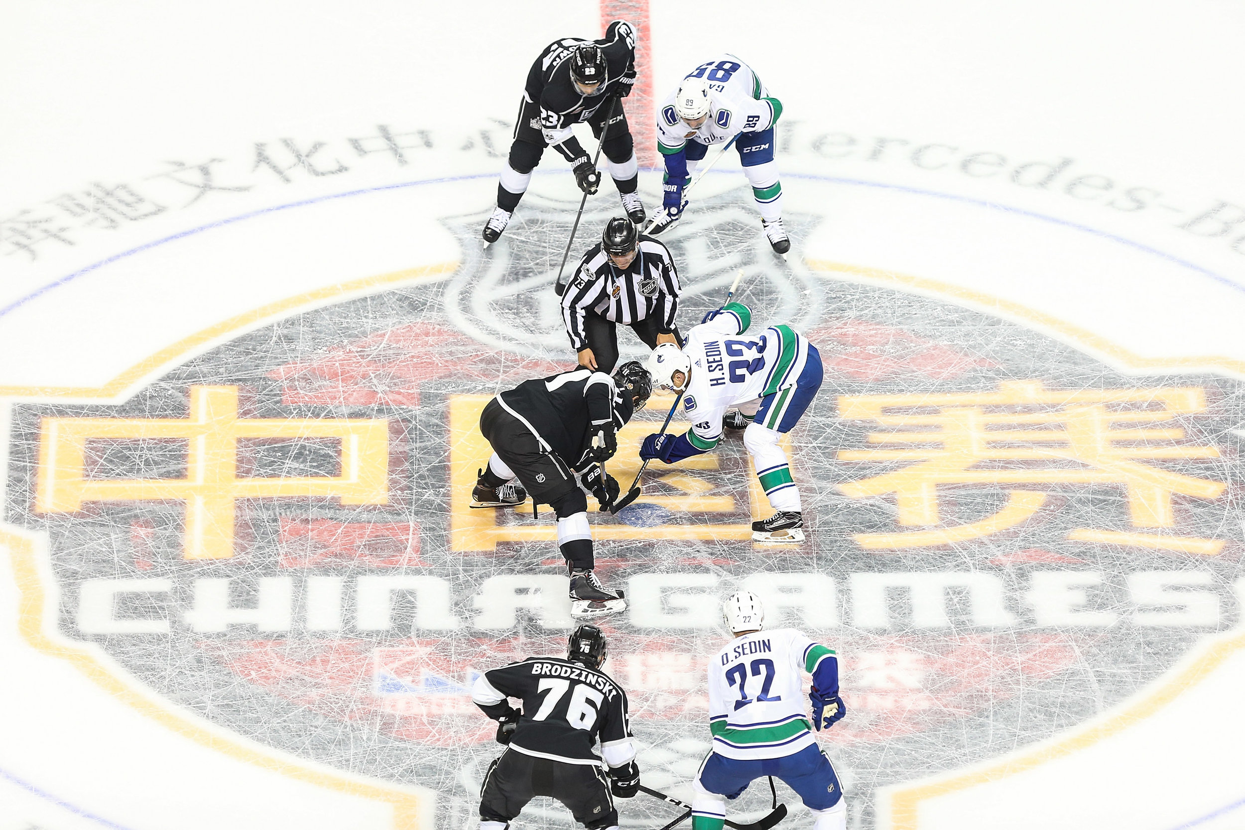 Players faceoff during a pre-season NHL game between Vancouver and Los Angeles at Mercedes-Benz Arena on September 21, 2017, in Shanghai.(Yifan Ding/Getty Images)