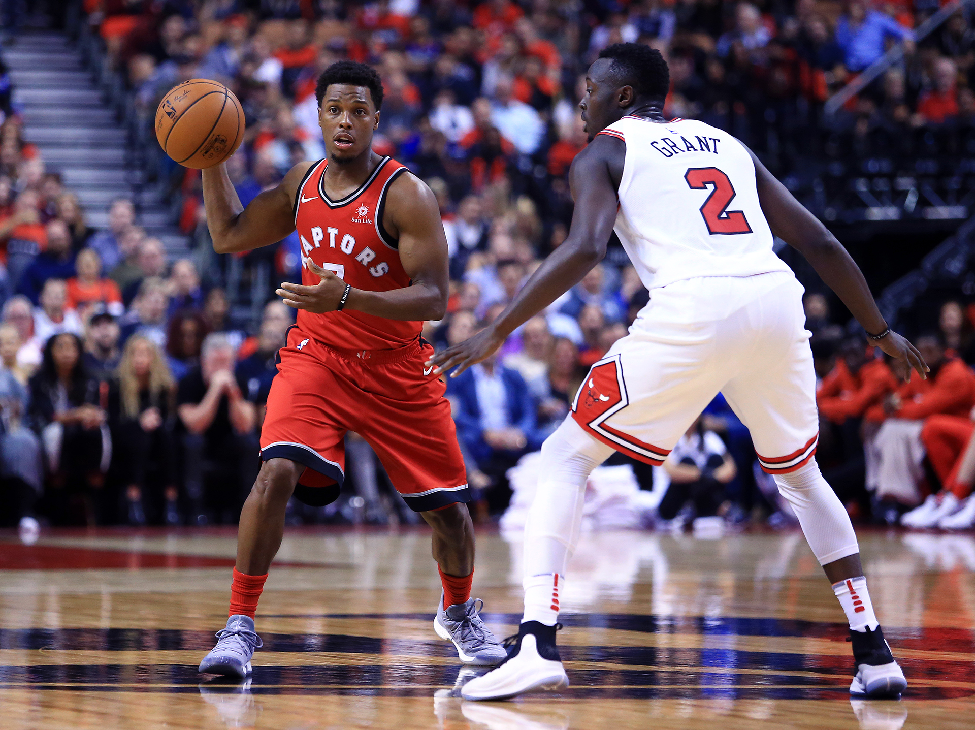 Kyle Lowry of the Toronto Raptors passes the ball during the second half against the Chicago Bulls at the Air Canada Centre on October 19, 2017 in Toronto, Canada. The Raptors beat the Bulls in their season opener 117-100. (Vaughn Ridley/Getty Images)