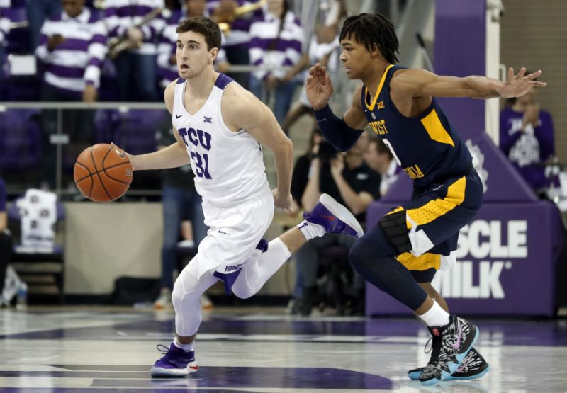 TCU guard Owen Aschieris thought he was in trouble when a police officer interrupted their team meeting. Next thing he knew, he had earned a scholarship. (AP Photo/Tony Gutierrez)
