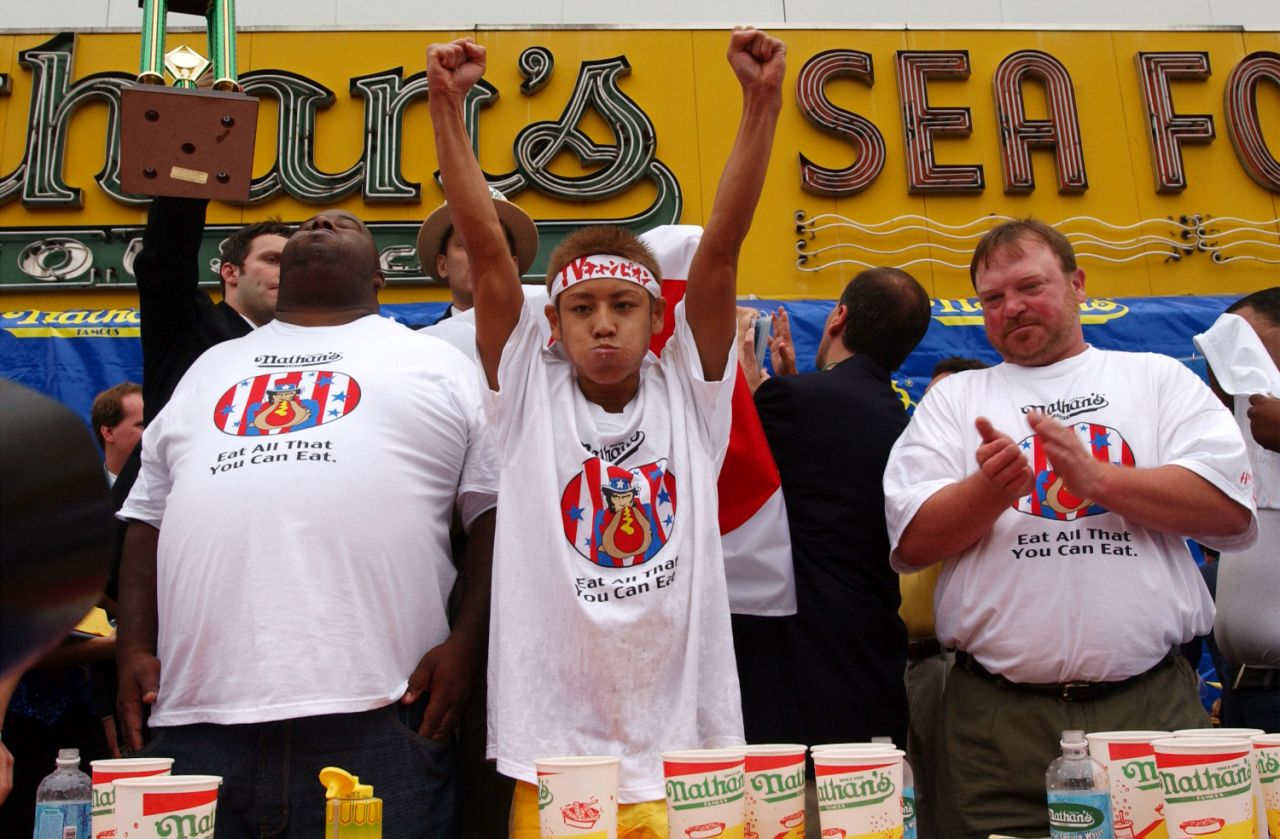 23-year-old Takeru Kobayashi raises his hands in victory July 4, 2001 at the 86th annual Nathan's Hot Dog Eating Contest at Coney Island in Brooklyn, New York. (Spencer Platt/Getty Images)