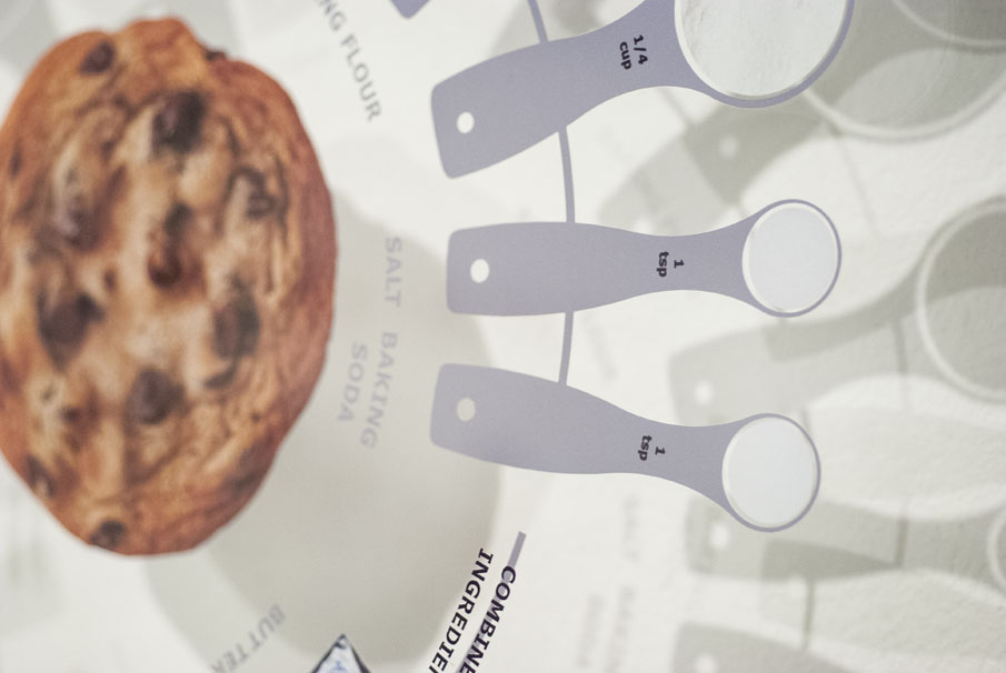 Cookie image, measuring spoon, and measuring cup graphics.