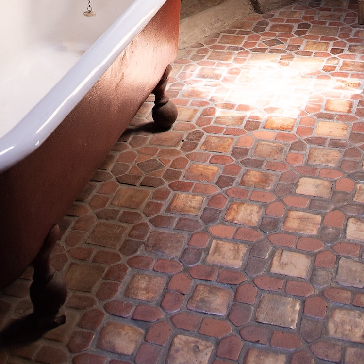 Saltillo tile with a clawfoot tub