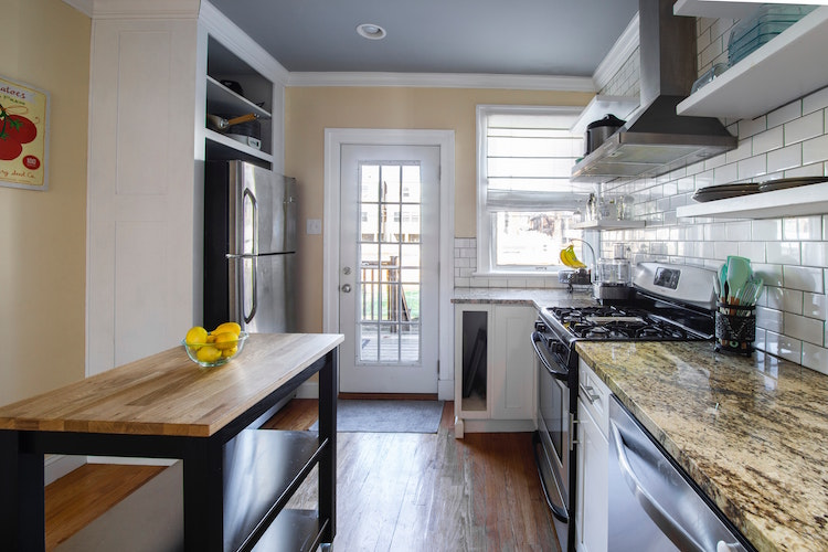 kitchen with movable island and granite countertops