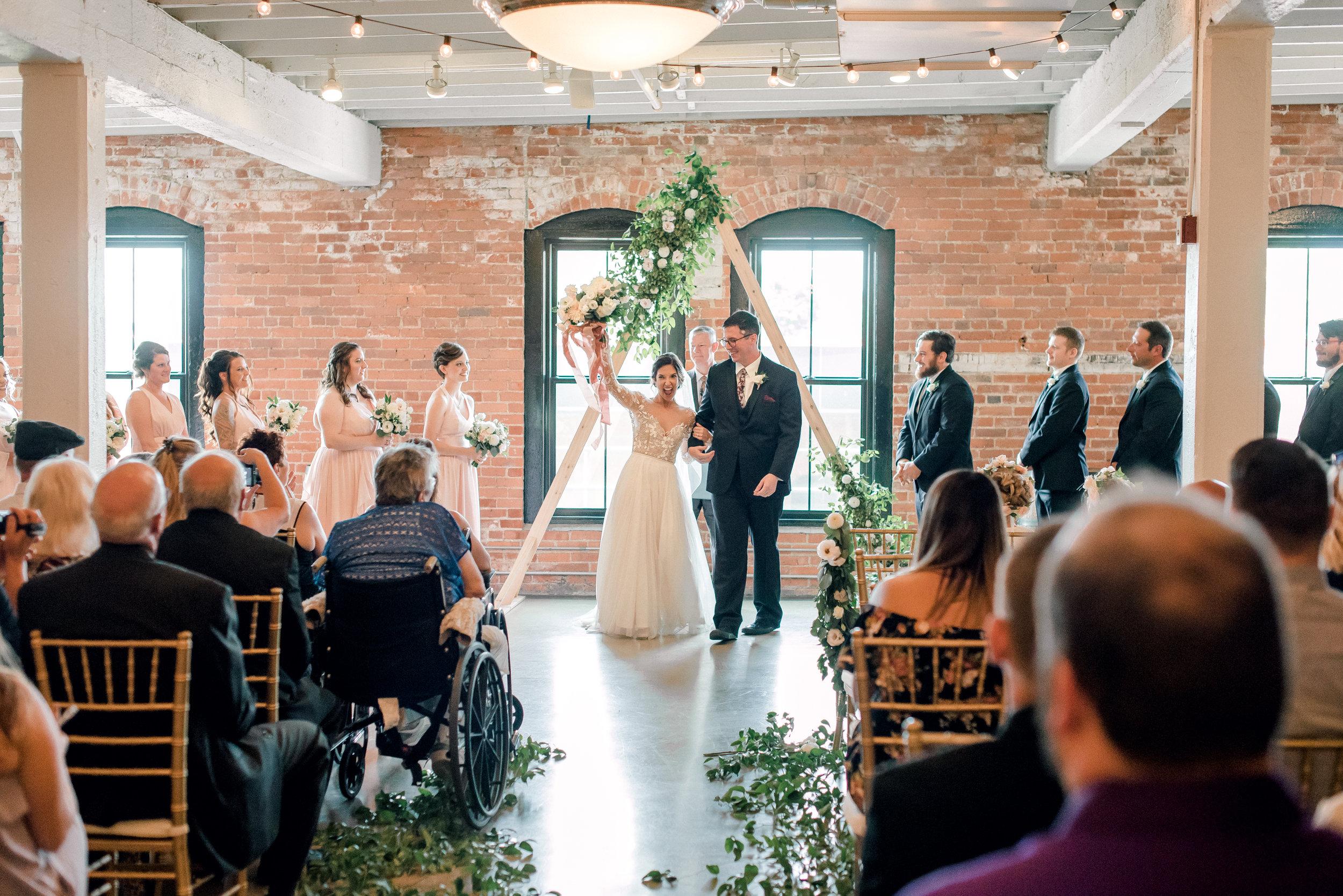 cleveland-wedding-photographer-great-lakes-brewing-arcade-0047.jpg