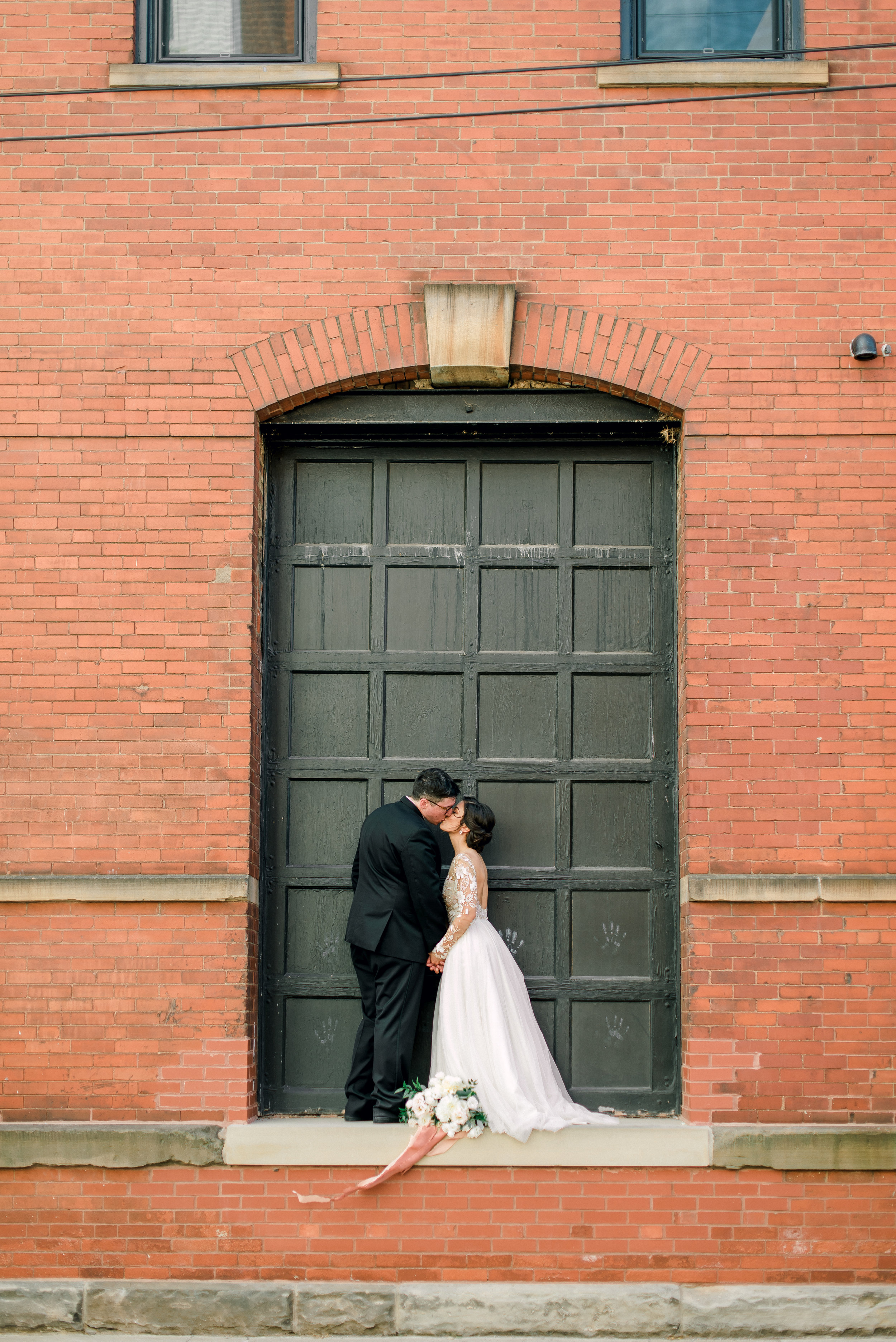cleveland-wedding-photographer-great-lakes-brewing-arcade-0057.jpg
