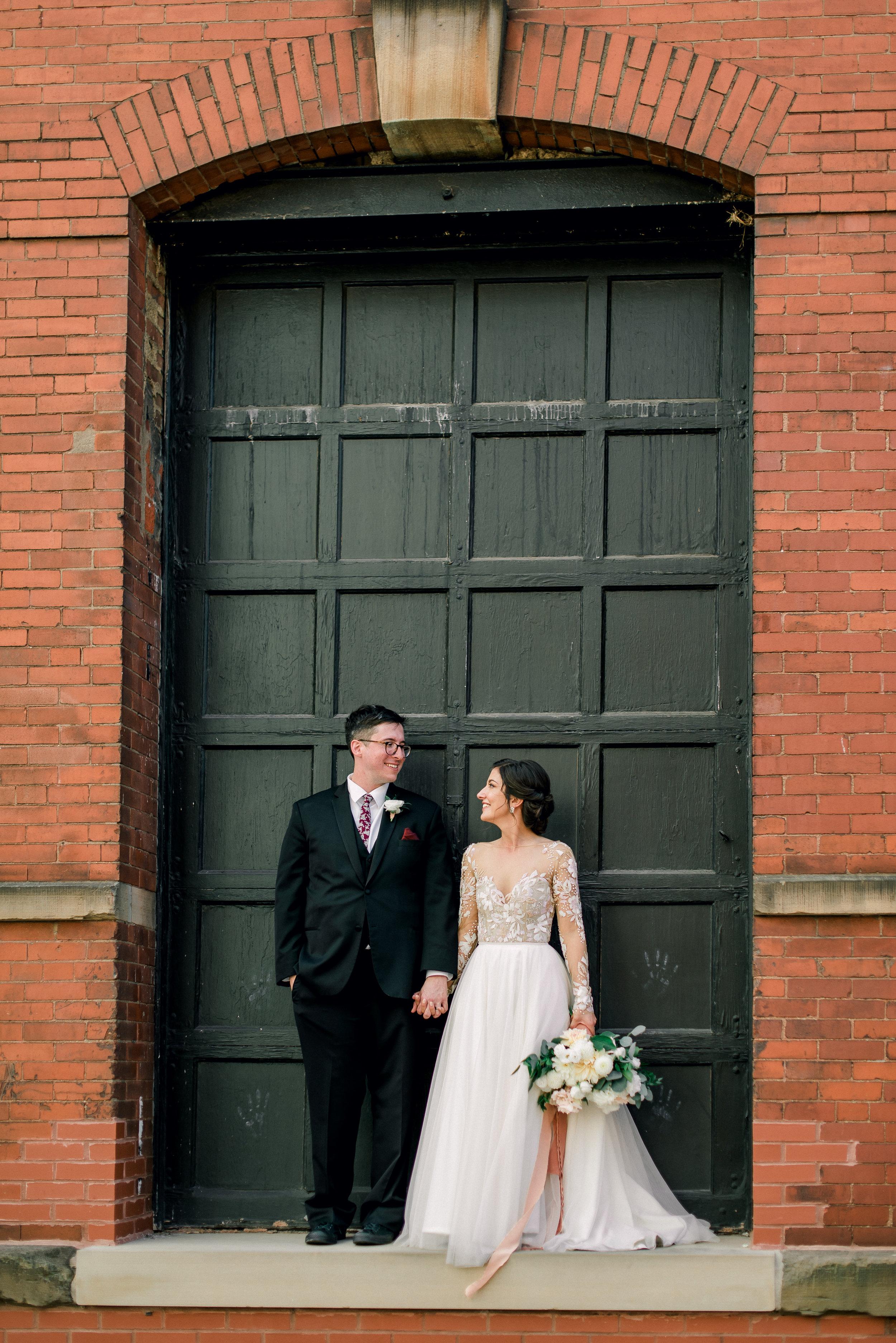 cleveland-wedding-photographer-great-lakes-brewing-arcade-0058.jpg
