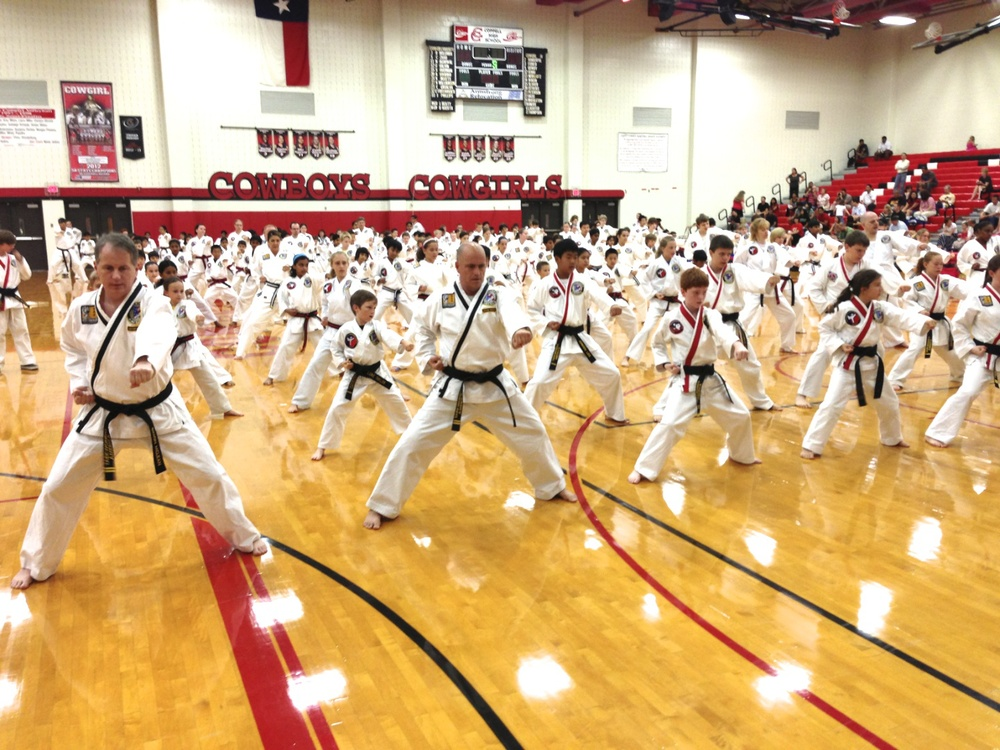 Students warming up at a martial arts Belt Test.