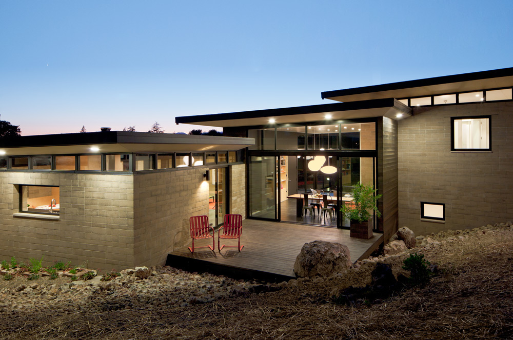 Modular building principles were continues for this  modern home in Napa built with pre-fabricated rammed earth Watershed Block .  Two building structures are separated by a third space that, when roofed, becomes a third living space.
