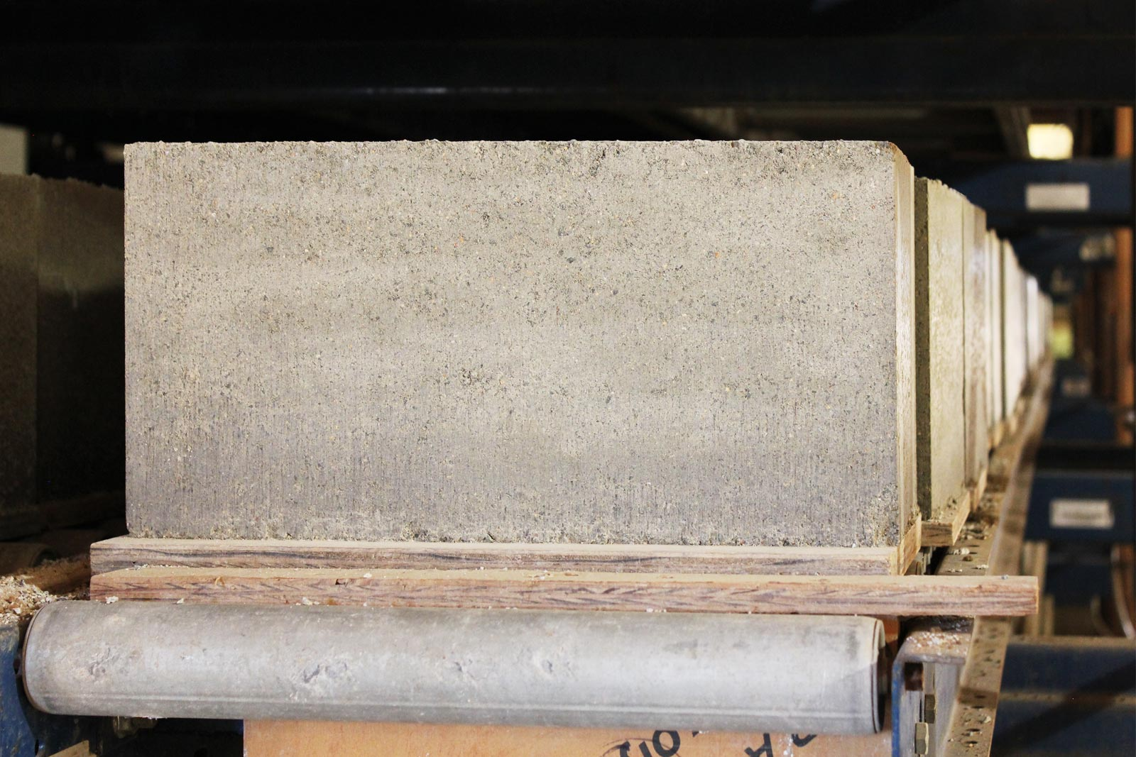 Block curing after manufacturing. The block's white appearance emerges during the curing process.