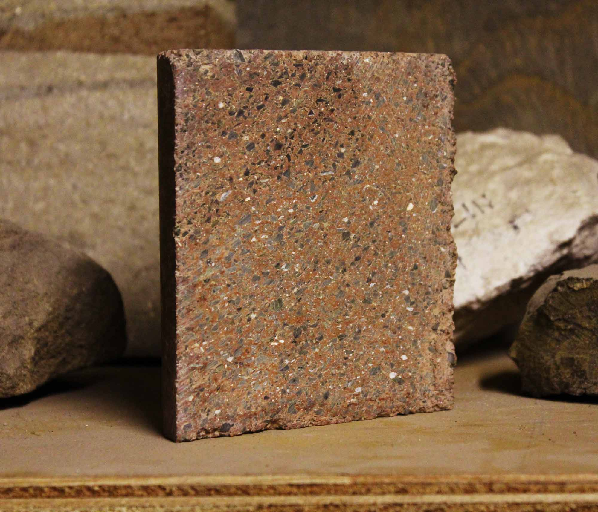 Saw-Cut Half Cylinder Test Sample of Watershed Materials' New Geopolymer Masonry