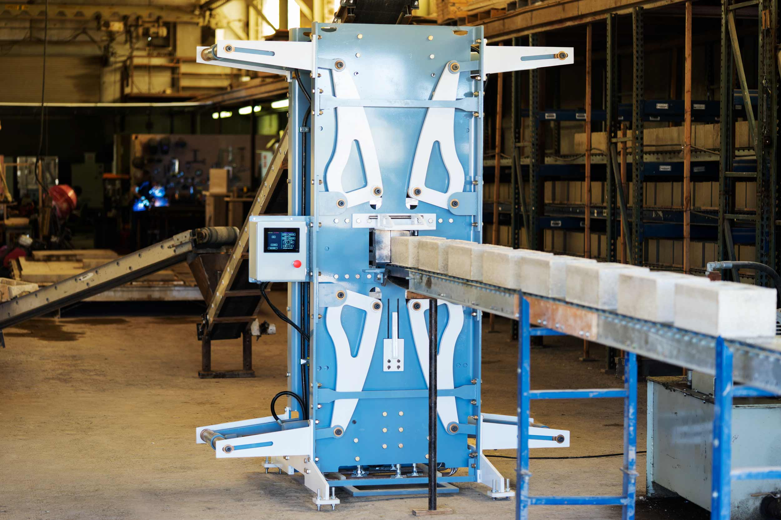 Watershed Materials' high compression masonry block machine imparts 500,000 pounds of compressive force to produce low cement alternatives to traditional concrete masonry units (CMUs).