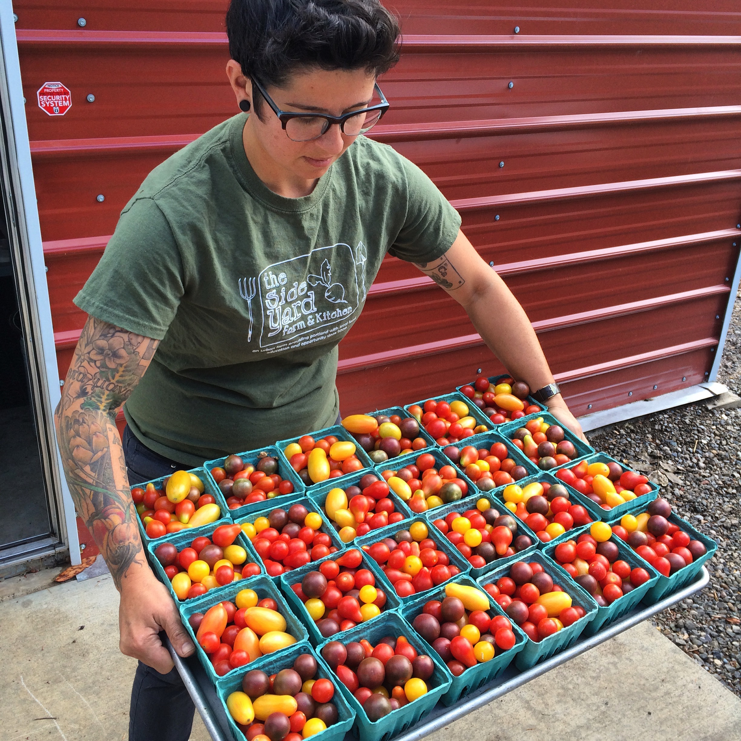 Stacey Givens of  Side Yard Farm and Kitchen  with a serious haul of cherry tomatoes!